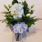 blue flowers in basket